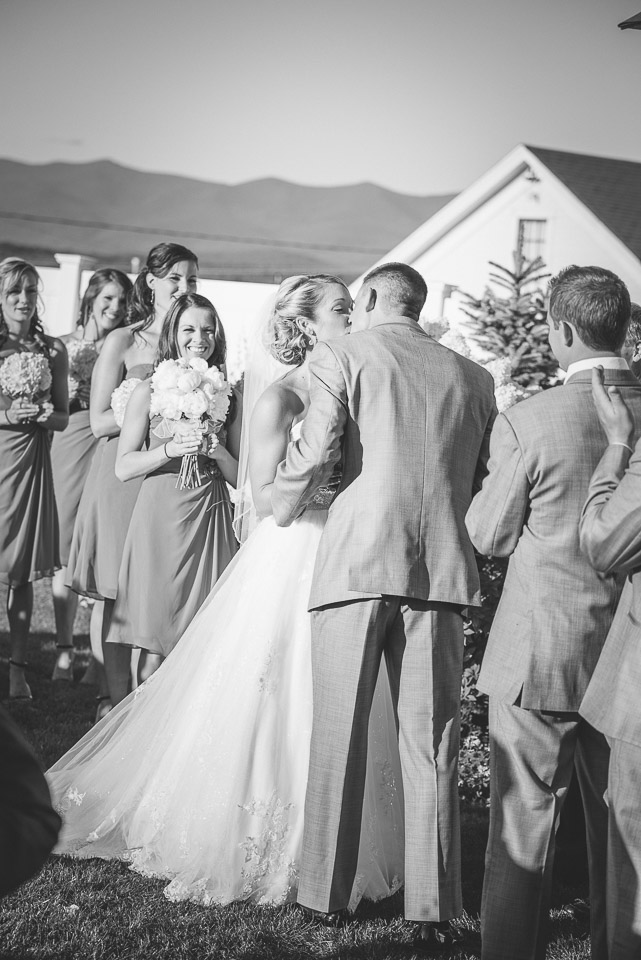 NH Wedding Photography: bride and groom first kiss