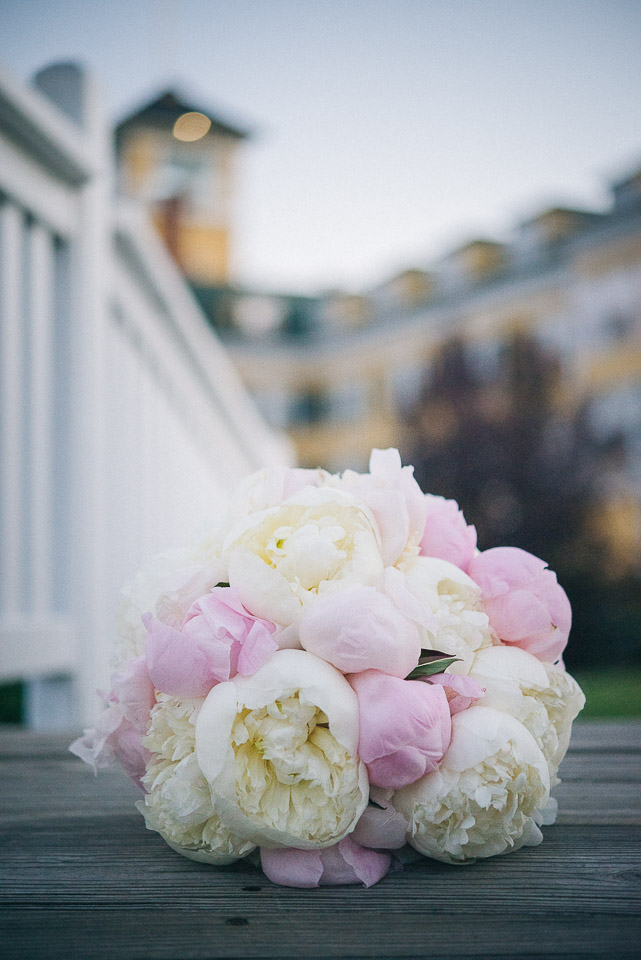 NH Wedding Photography: bridal bouquet on bridge