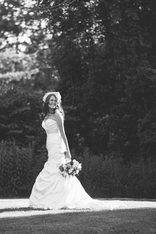 NH Wedding Photographer: Bedford Village Inn bride with bouquet