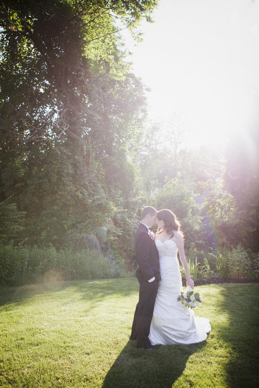 NH Wedding Photographer: Bedford Village Inn couple in sunlight