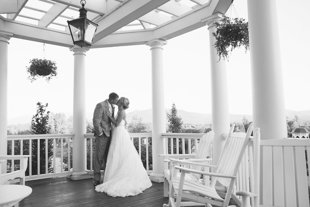 NH Wedding Photographer: couple on porch of Mountain View Grand