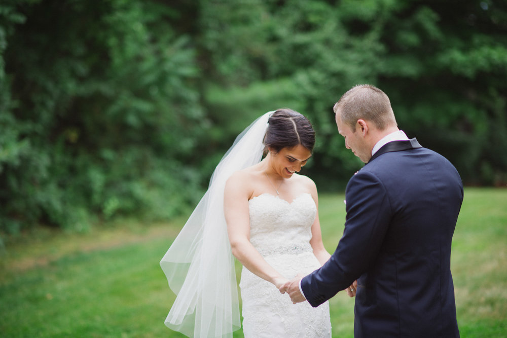 NH Wedding Photographer: couple holding hands during first look