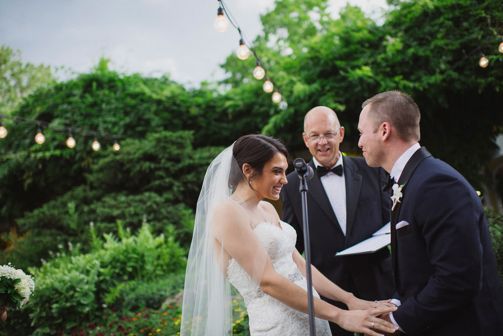 NH Wedding Photographer: ceremony under lights Bedford