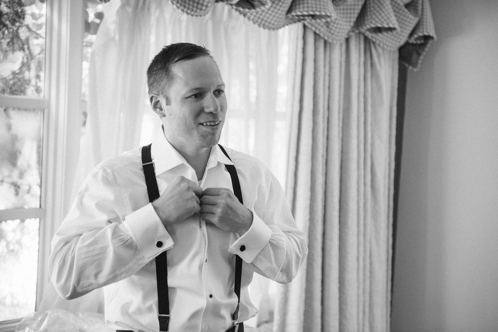 NH Wedding Photography: groom tying tie