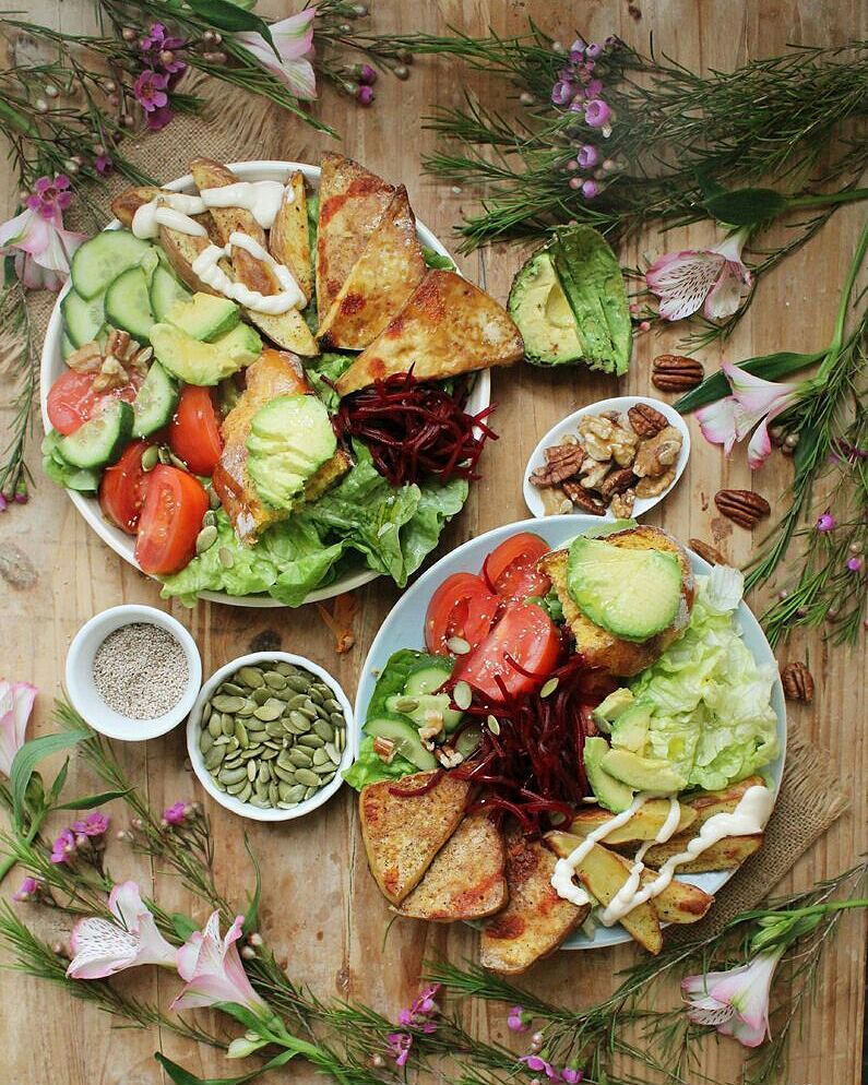"Brunch  on a Sunday? Have a butter lettuce, tomatoes, cucumber, pickled beetroot, ""crack"" tofu, baked paprika fries and avocado on pumpkin sourdough salad!"