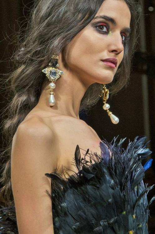 Alberta Ferretti's dark dramatic lines and baroque earings.