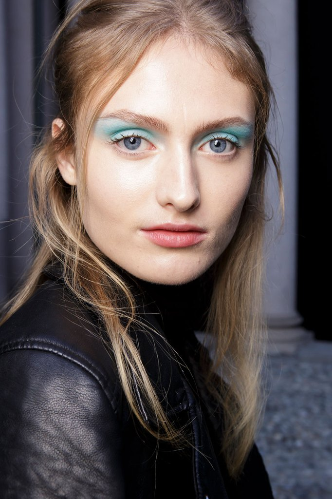 Byblos's soft vibrant blue eye shadow and tied back hair coexisted perfectly with the collection's clean lines.