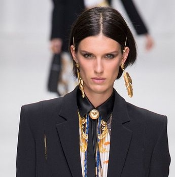 Versace's straight hair lines and dark eye really stood out.