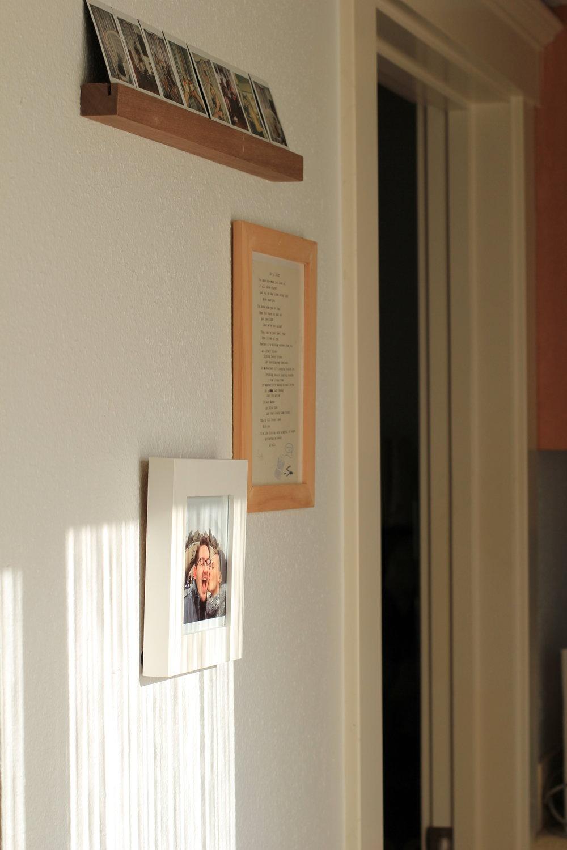 Hallway Light and rustic photo frames - Que Sera Sahra's SF home