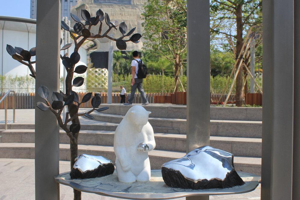 Sad Polar Bear is sad because its world is melting. Global Warming art installation in Hong Kong
