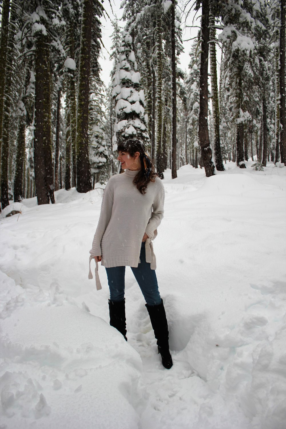 Snowy Winter Outfit in Tahoe with Good American Jeans