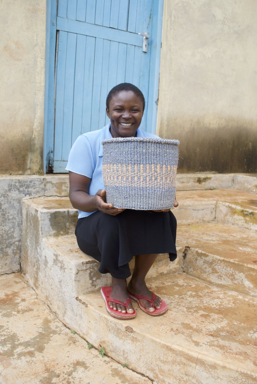 """"""" I learnt how to weave baskets from my mother. I joined Rukanga Basket Weavers because the leaders work for the betterment of their members. The group is hardworking and united and many of my baskets have been sold through my association with them. The profits I get I use to educate my children and buy food for my family.""""  Eunice - Rukanga"""