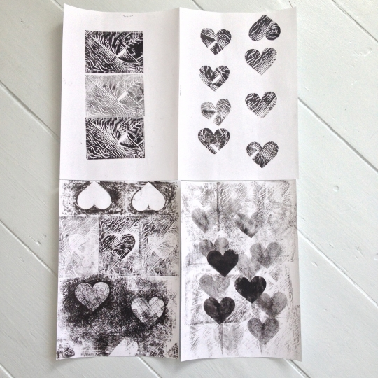 Lilla offers her recycled Dorset Cereal boxes. These beautifully designed little boxes come with a small heart cut out to show the cereal inside the box. Meg brings some grey Lino to carve. I bring a Matisse cut-outs postcard from the Tate Modern for inspiration and off we go…  Using the cut-out hearts I mask off part of the lino cut making some fun hearty patterns leading into more hands-on finger smudging inksploration.
