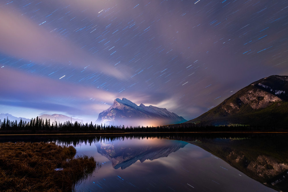An 8 minute exposure created star trails over Mt. Rundle in Banff National Park