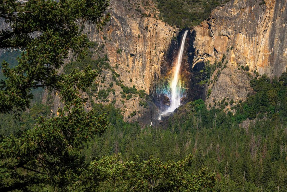 My first trip to Yosemite was short and sweet. Tunnel view was the first stop I made with my mom and the kids. I captured this image of Bridalveil Falls with my Nikon 70-200 at 200mm and was thrilled to see the rainbow of colors in the water.