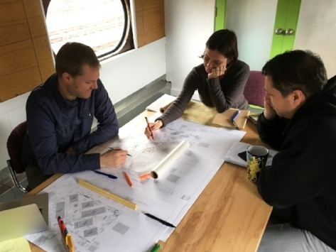 Birdsmouth designers Jonathan Lundstrom (left) and Ben Valentin look over Going Street Commons preliminary designs with landscape architect, Caitilin Pope Daum in April, 2017.