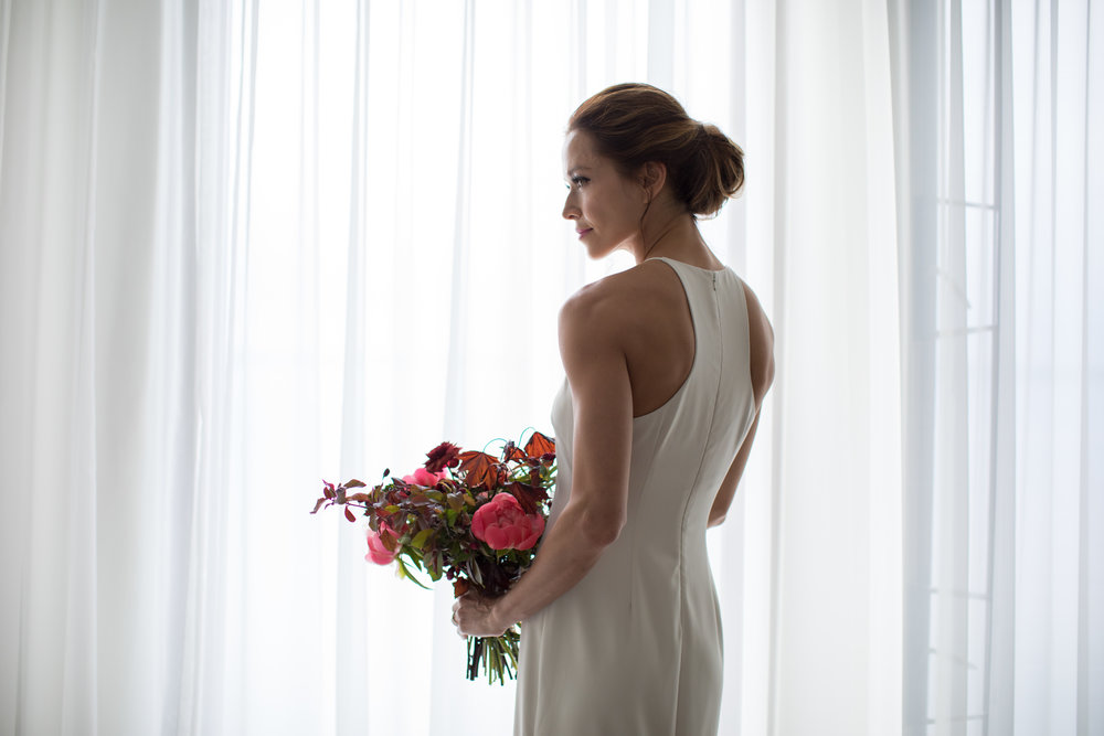 Midwest wedding photographer - bride getting ready by window