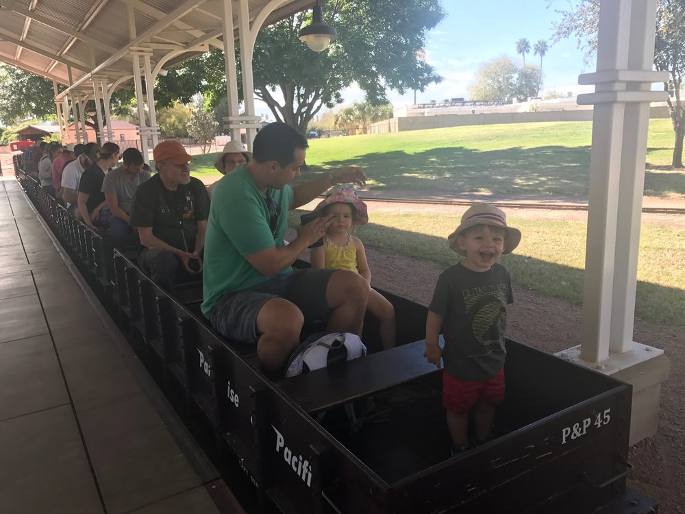 Henry couldn't contain his enthusiasm as we all took our seats to ride the rails at the Mccormick-Stallman Railroad Park.