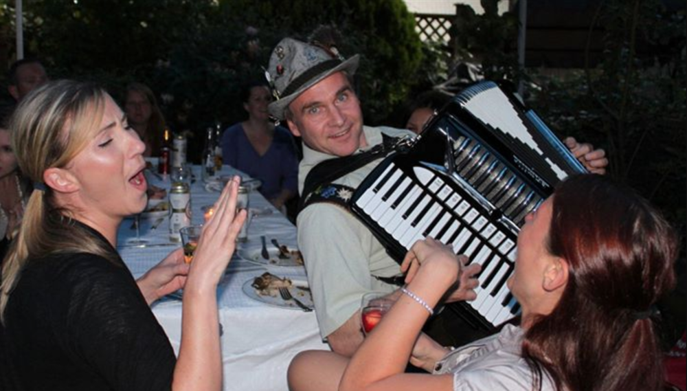 Photo of Franzl and his Squeezebox at Tractorgrease Cafe in Chilliwack, who also host several Oktoberfest events (good ones too, judging by this photo...)