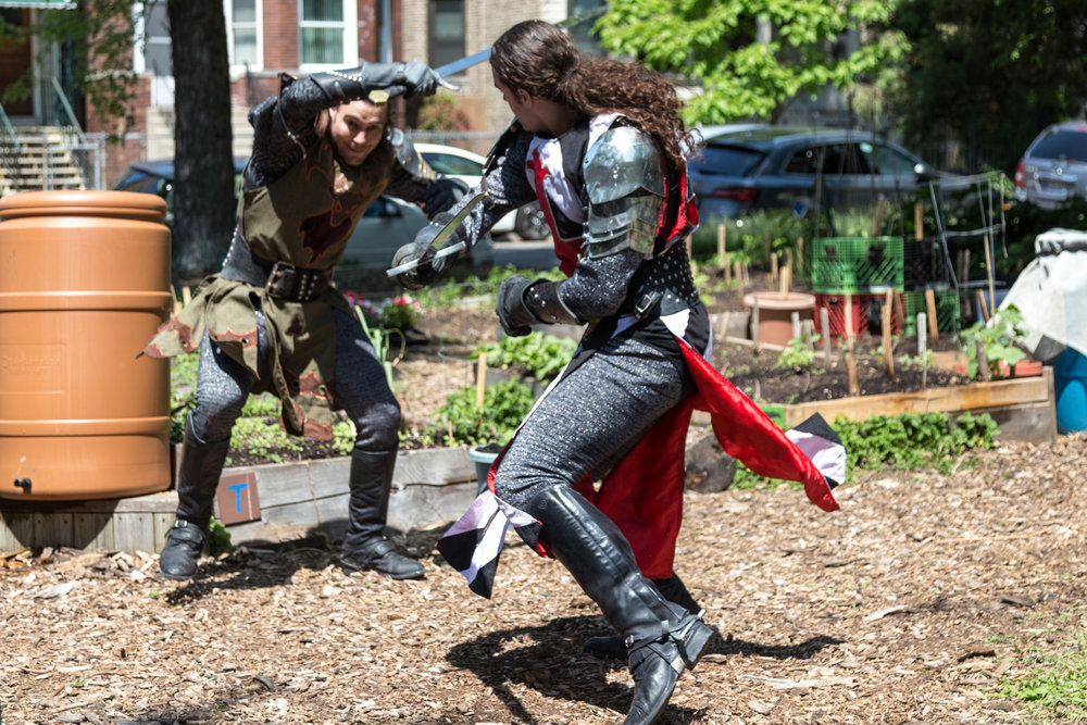 The Black & White Knight (Alec Lukie) and Green Knight (Michael Kiburz) battle at the Altgeld Sawyer Corner Farm.