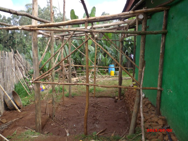 Here it is waiting for tin on the roof and concrete on the floor. Then cover the walls with tin or bamboo and we'll be ready to start cooking.