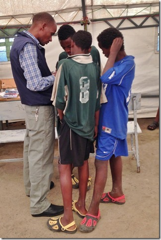 Alex talking with some of the children at the Drop-In Center