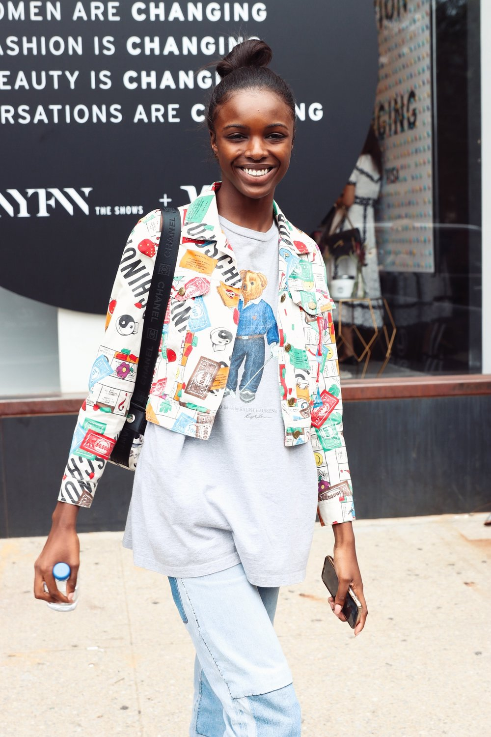 "Leomie Anderson.   ""Leomie!  May I get some shots of you?""  She said, ""Sure.""  Guys.  I was so pumped.  I follow Leomie on Instagram and she's one of my favorite models.  I. Was. Pumped!  As you can see on my Portfolio page, she gave me some model LOOKS.  Simple, but SO GOOD.  AHHH!  After I snapped about 7 shots, she said, ""I've got to run.  I'm already late.""  I thanked her and she hurried off.  I assume she was heading into the studio to prepare to walk in the next show.  At this point I realized that Caila had walked off and I felt so bad because I interrupted her right as she was telling me her Instagram.  I saw her up ahead and ran after her and apologized and asked if she could give me her Instagram.  She was so sweet and understood and wasn't bothered by my slight rudeness earlier (hey, a photog has to get her shot!)  She said, ""My Instagram is @Caila..."" I started typing and asked, ""Just Caila?""  She said, ""@CailaQuinn.""  I said, ""Oh! I know you!""  She said, ""Probably from The Bachelor.""  I said, ""That's it.""  (If you don't know she's also a blogger and influencer now as well.)  I thanked her and she headed off.  Less than a minute later, I saw her heading back my way, so I lifted my camera and..."
