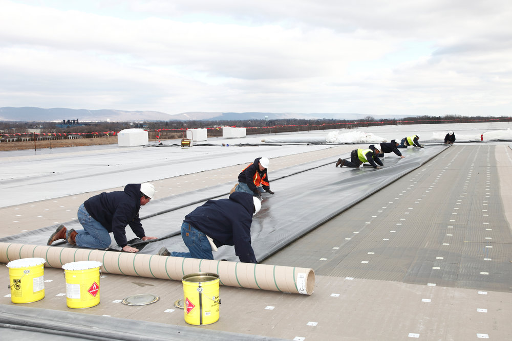 sure-seal-epdm-roof-install---carlisle-warehouse_19728092978_o.jpg