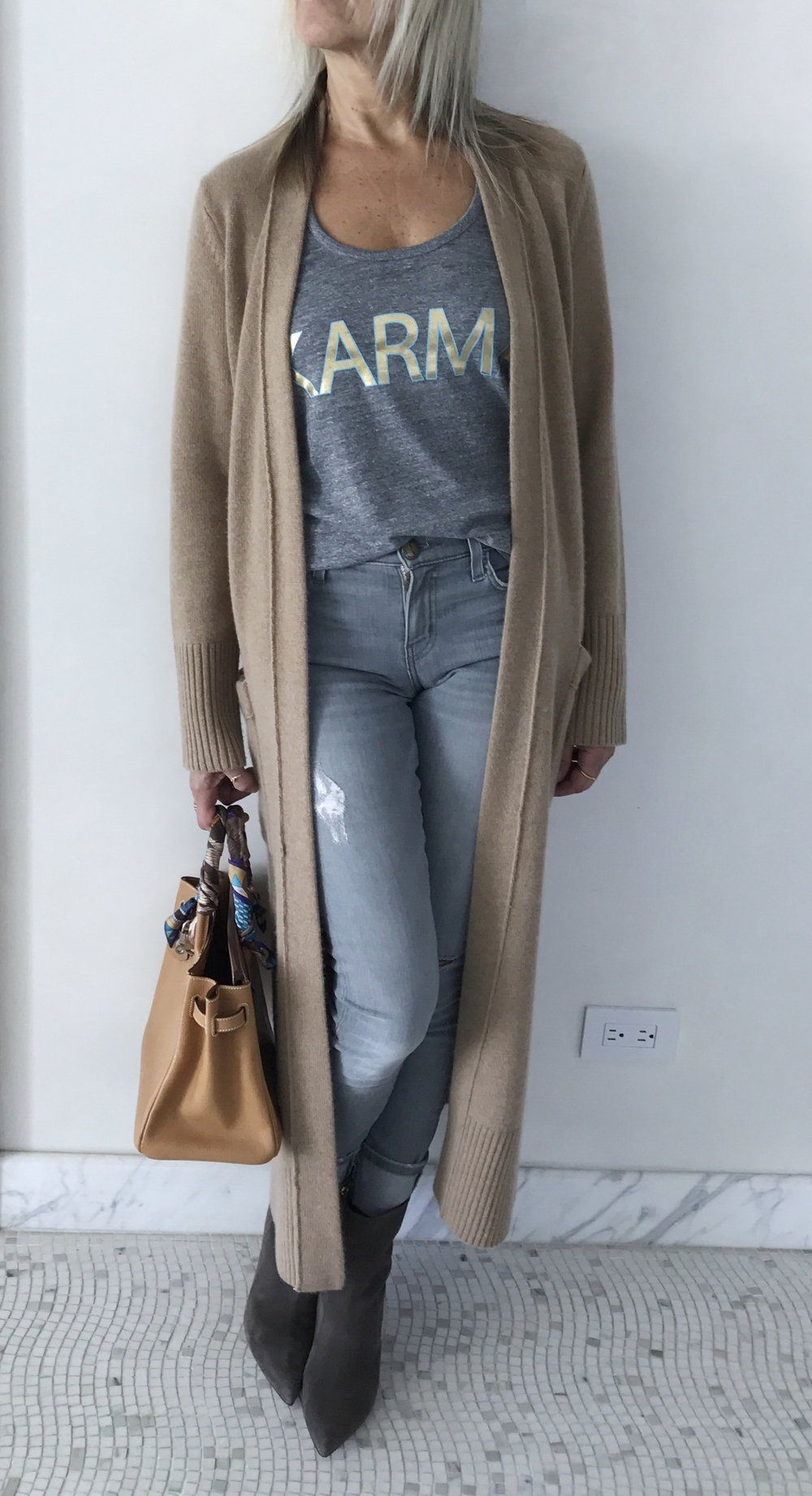 This long cashmere cardigan or sweater coat from Lou & Grey is the perfect transition piece and is as comfy as it looks. It also says chic, modern and TODAY. A huge plus is that it hides literally everything you'd want it to!! Wear it belted or open to boost the lowliest jeans and tee to new heights.