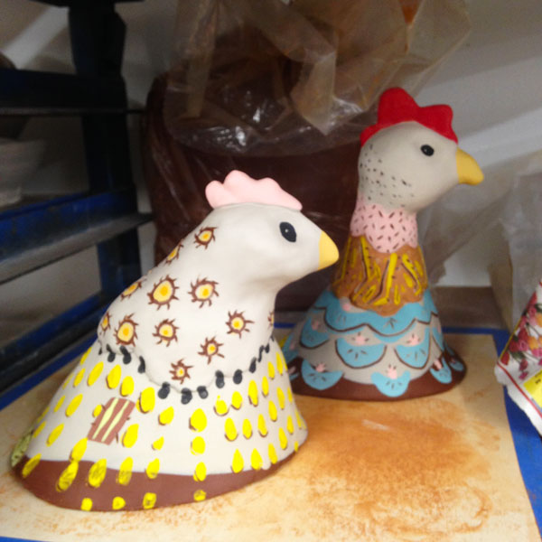 Drying on the shelf, Dot (L) and Jenny (R) after being painted with underglazes.