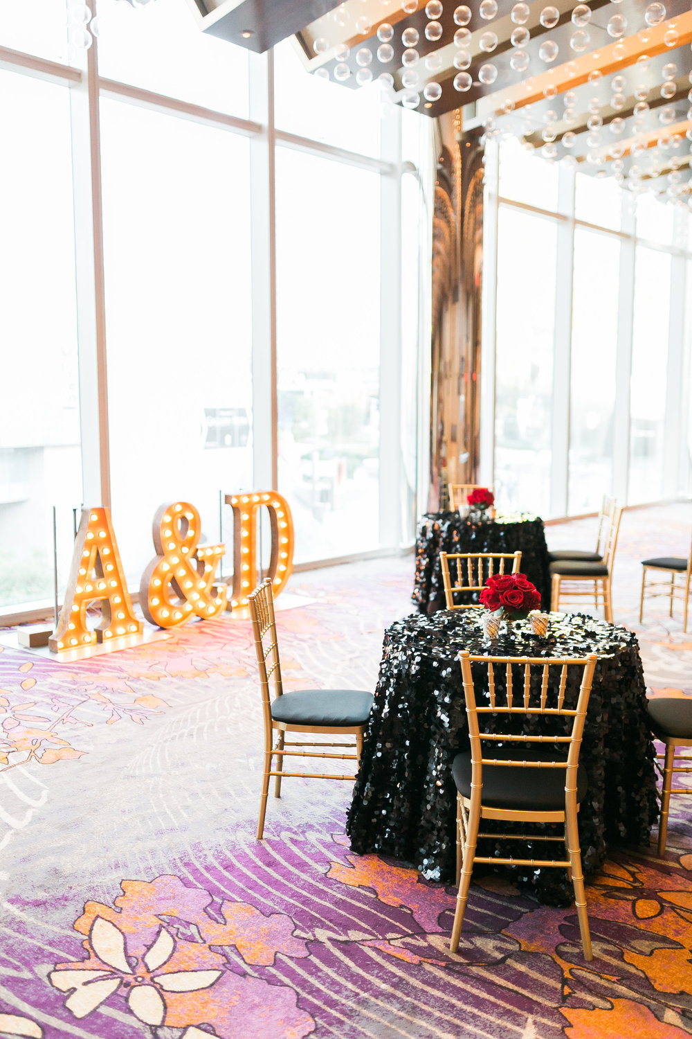 The couple's initials were in marquee letters while the cocktail hour was decorated in black sequence linens.