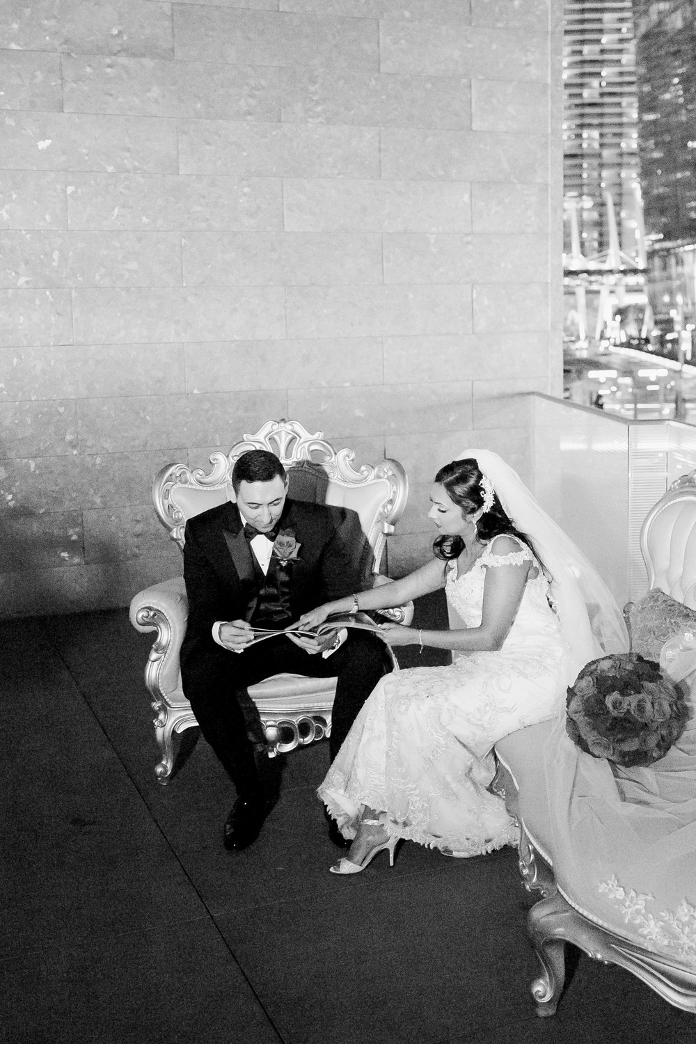 Bride gives groom a magazine about their life together.    Las Vegas Wedding Planner Andrea Eppolito.  www.andreaeppolitoevents.com  Photo by J.Anne Photography.  www.j-annephotography.com  As seen on The  Wedding Editorialist  Wedding Blog.