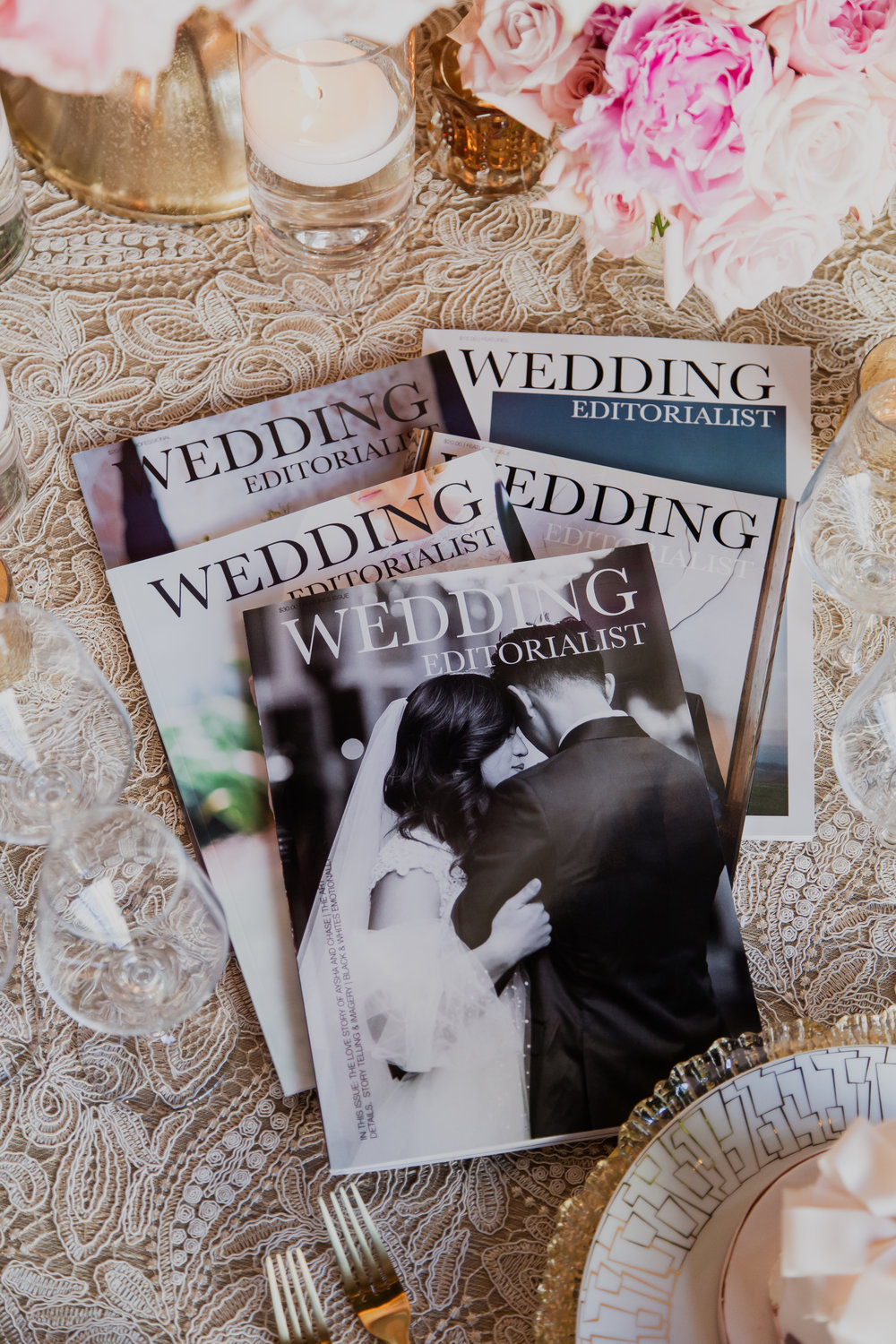 Copies of Wedding Editorialist. Customized wedding magazines made for couples in love.