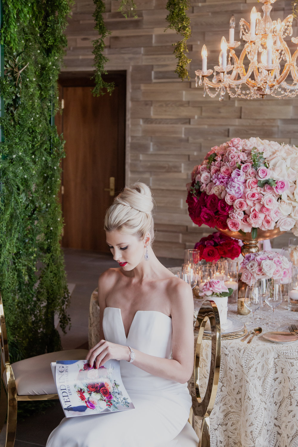Bride reading her custom wedding magazine.Personalized wedding magazines! Made to order for couples in love. Photo by Adam Frazier.