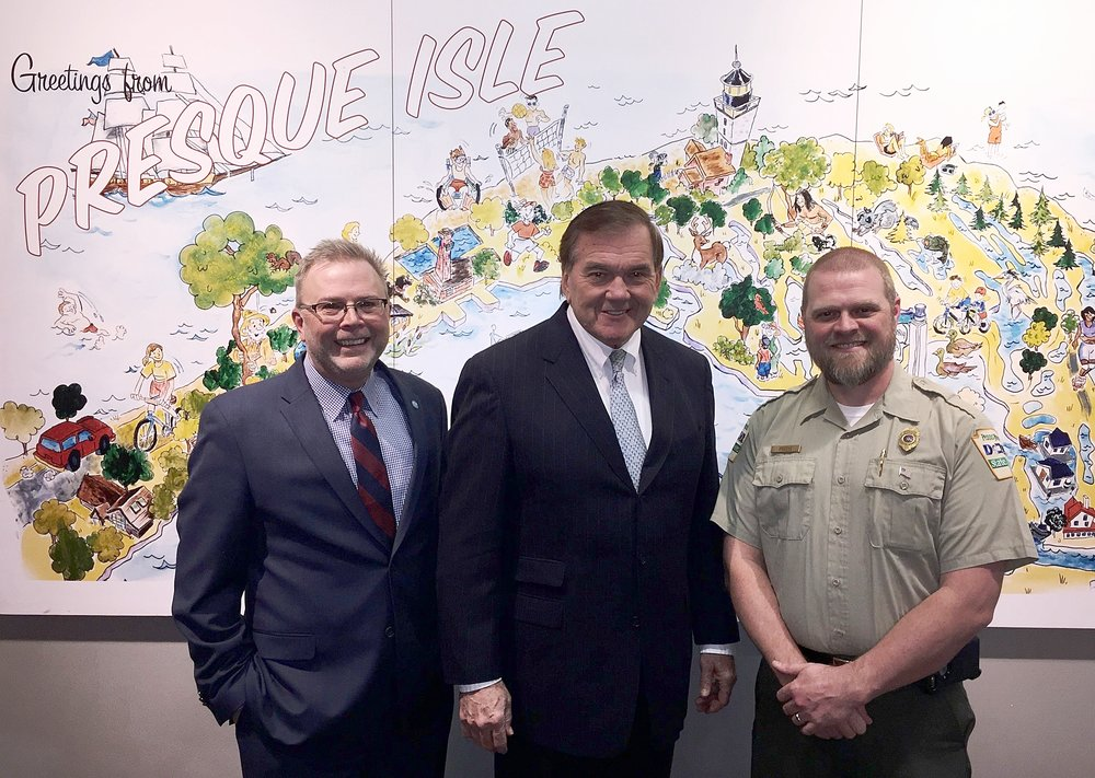 TREC Foundation's David Martin (left) and Presque Isle State Park Operations Manager Matt Greene (right) recently met with Governor Ridge at the Tom Ridge Environmental Center on Presque Isle.
