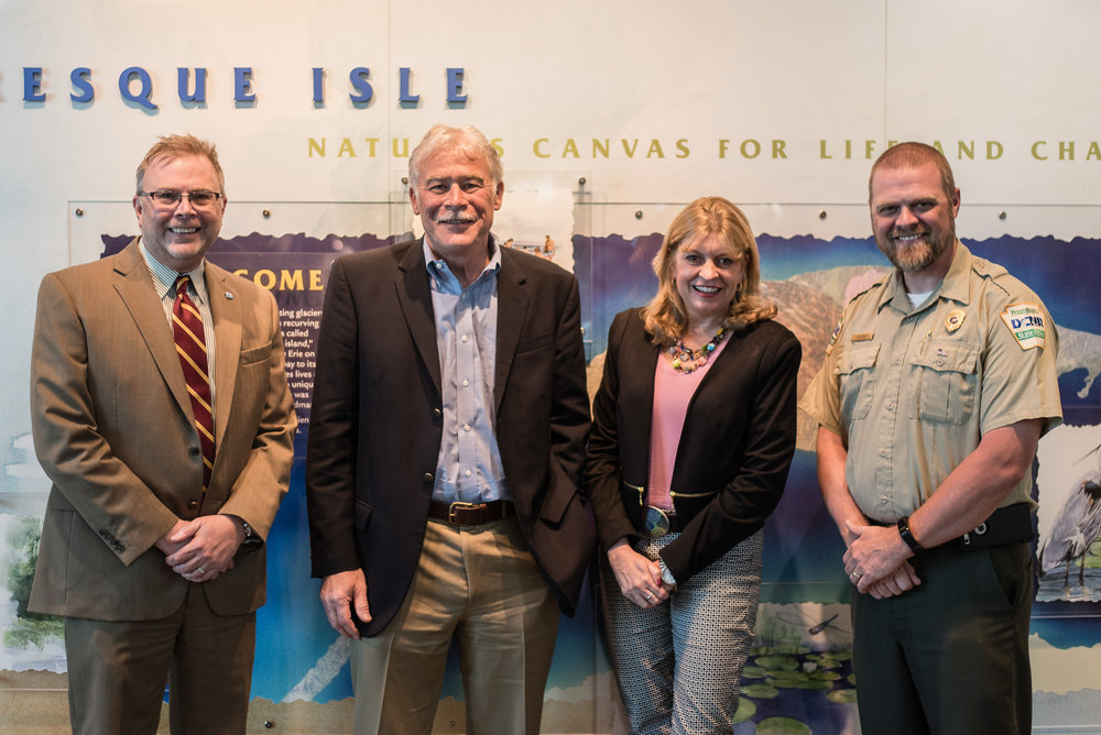 From L-R - TRECF's David Martin, Mike Batchelor, President & Erin Fessler, Vice President of Marketing, Erie Community Foundation and Matt Greene, Operations Manager, Presque Isle State Park.