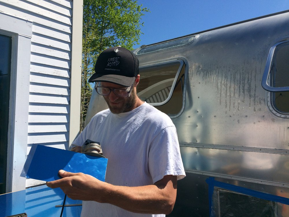 Aaron Bulger helping to cut some new aluminum for exterior patch work.