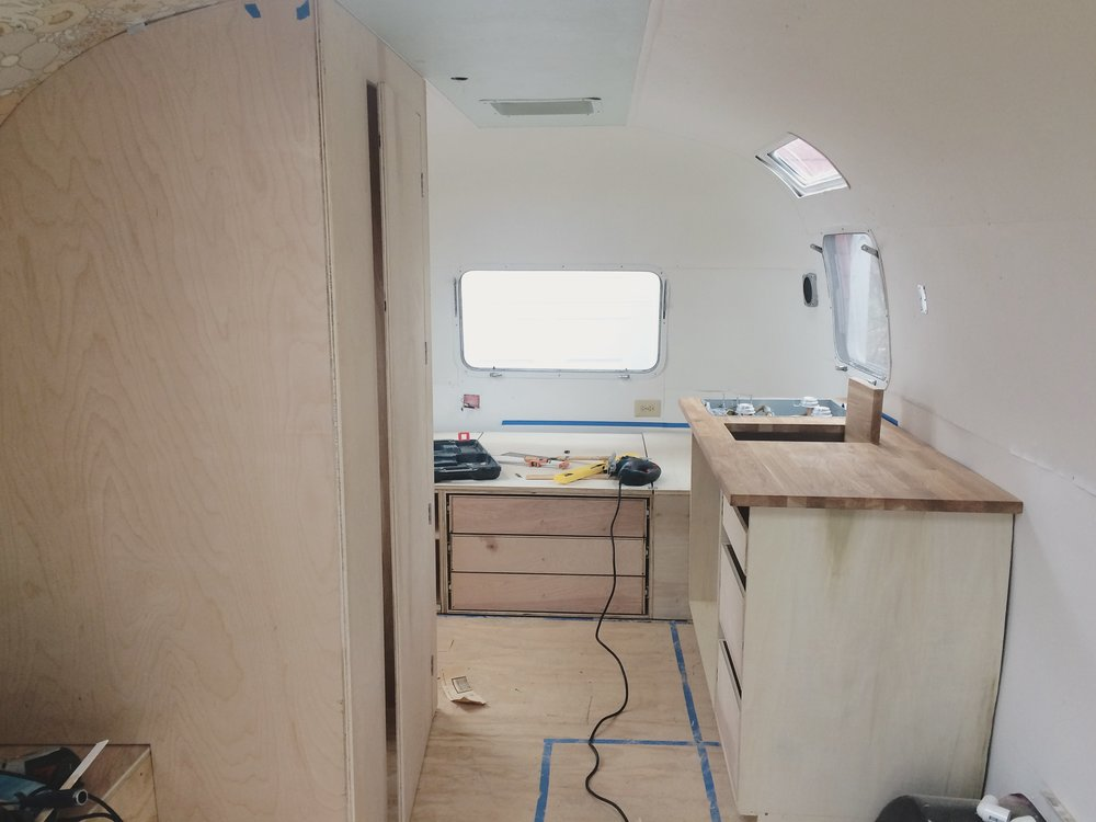 The Airstream mid-construction, December 2017. The studio is outfitted with a small kitchenette and sleeping quarters, for off-grid living while documenting along the Maine coast.