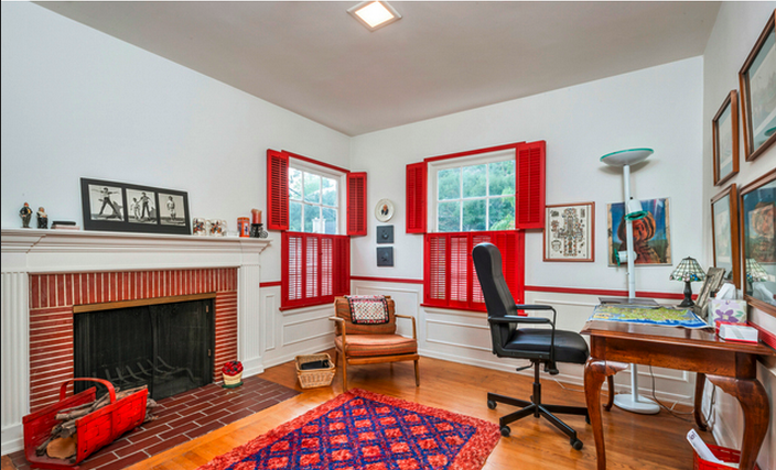 A 5th room trades a closet for a fireplace and is currently employed as an office – a cozy cutaway in a house mostly comprised of wide open spaces. The brick fireplace and red shutters are an overt but well-executed match.