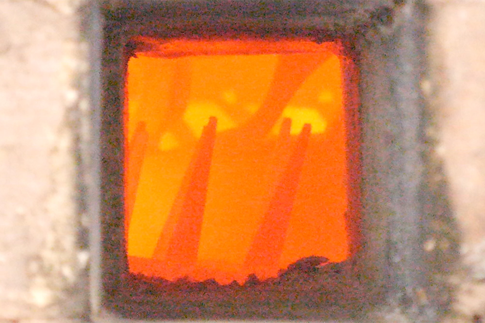 The view through the peep at the cones during a firing.