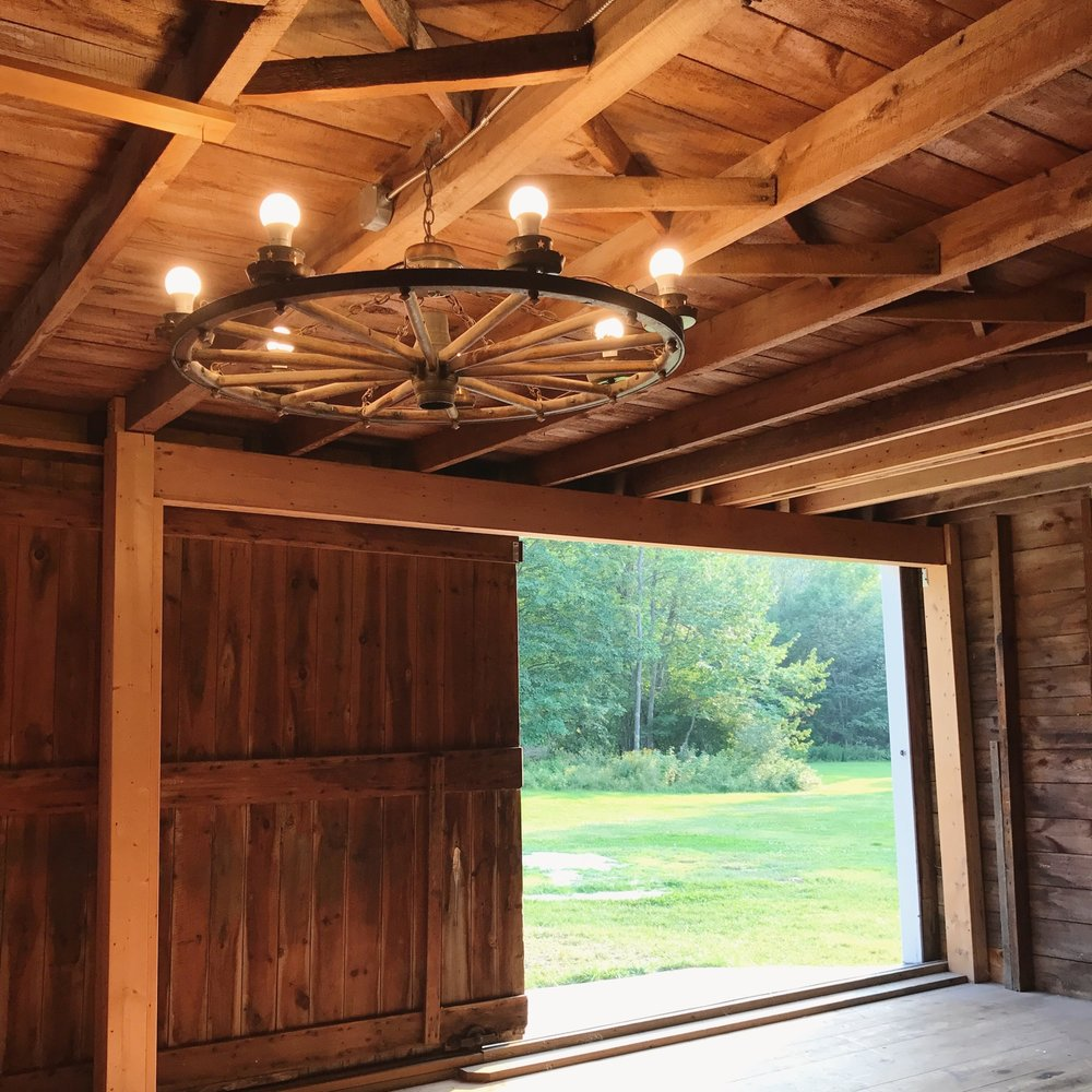 Wagon Wheel Chandelier Goes Up in the Carriage Barn!