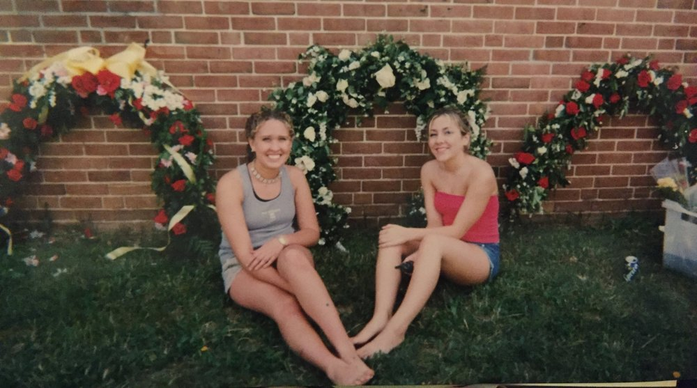 Stephanie and I (left) with our graduation rose arch