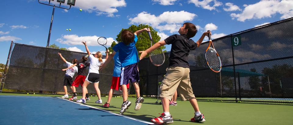 Tennis kids serving.jpg