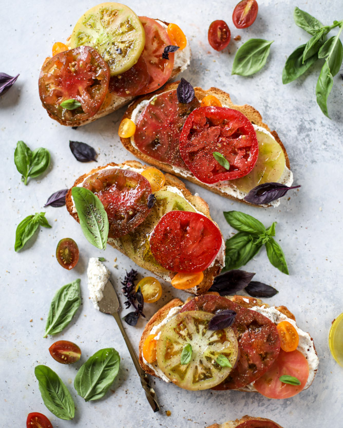 Heirloom Tomato Garlic Toast with Basil Whipped Fetta  Image credit: Jessica,  How Sweet Eats