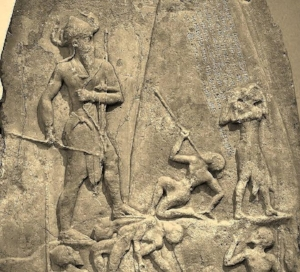 Large figure towering over men on the Victory Stele of Naram-Sin: a metaphorical or literal interpretation?