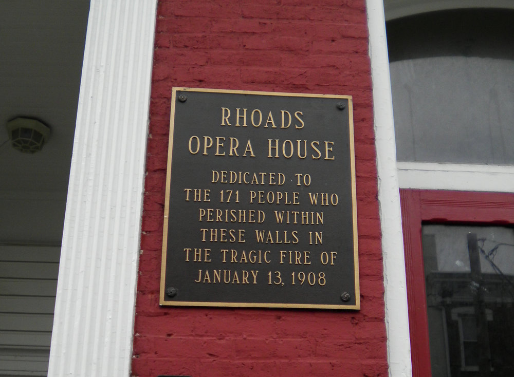 "The plaque on the former site of the Rhoads Opera House - ""Dedicated to the 171 people who perished within these walls in the tragic fire of January 13, 1908""."