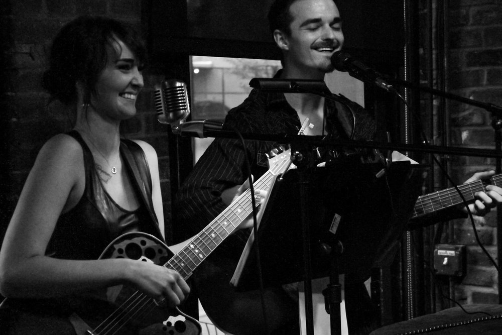 "The Nite Owls: Wyatt Brewer and Sarah Lynn, are an alternative/acoustic/folk duo. Based in Kansas City, we have been musically active since 2013.  With over four hours of music on hand, we cover everything from The Beatles, to Imagine Dragons. We love to play covers, as that lets us connect to our audience. It l  ets them   hear a   familiar tune, but with our signature style. With that being said, we also love sharing OUR music with the world! So far we have released two singles. ""We'll Be Fine"" was our first release. It was not only played on local radio stations 90.1 KKFI and 90.9 The Bridge, but it was also added to a compilation CD for locally owned MudStomp Records. This CD was passed out at the Folk Alliance International Conference in February of 2017, granting us airplay on folk stations in Switzerland, and Denmark. Our second single, ""Out of Touch,"" is freshly available  on ITunes and Spotify."
