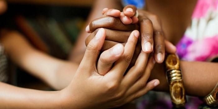 wpid-o-women-holding-hands-facebook-e1457821786354.jpg