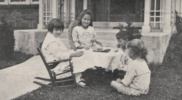 Four children having a tea party heralding the start of a new school year in 1918. (Courtesy of the UA Archives.)