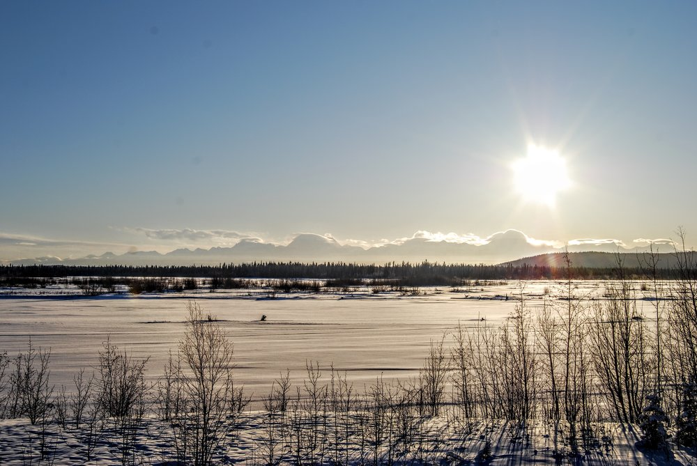 You can see the mountains we were trying to get to in the background and the frozen Tanana River in the foreground.